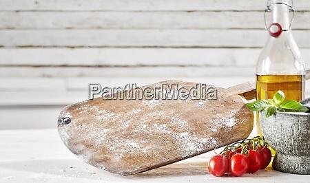 empty floured wooden pizzeria paddle