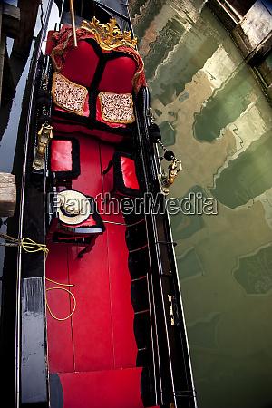 small canal red black gondola close