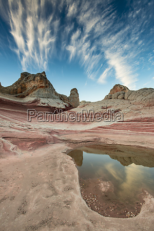 contrail pool reflection and sandstone landscape