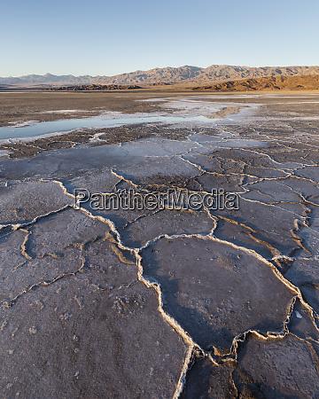 sunlight illuminates textured mineral deposits near