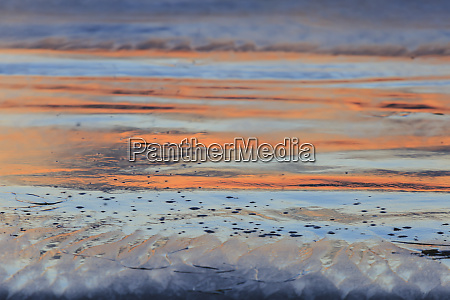 sunset reflection on pacific beach near