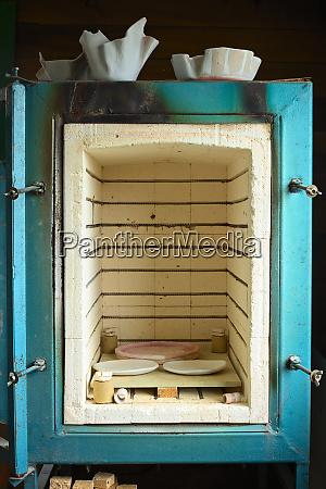 kiln with glazed pottery inside
