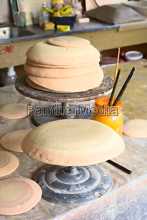 clay bowls on pottery wheels in
