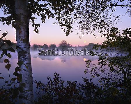usa maine pittsfield moonset at sunrise