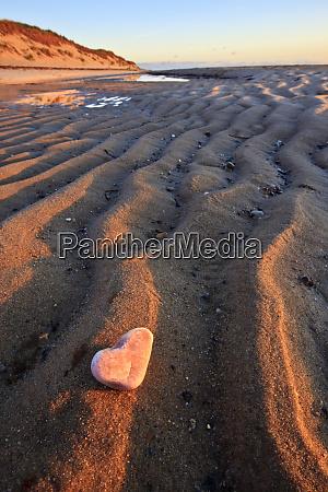 heart shaped quartz on the beach