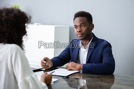 young businesspeople sitting at interview