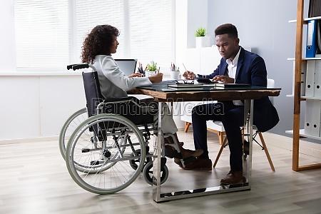 businesswoman sitting in wheelchair