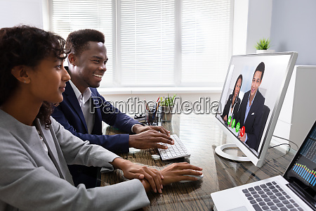 businesspeople videoconferencing with colleagues