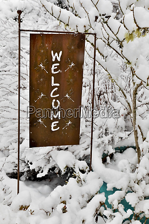 fresh snow on and metal welcome