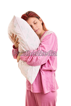 young girl in pajamas holding a