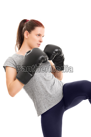 young girl with boxing gloves ready
