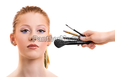 beautiful girl getting her make up