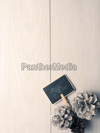 small blackboard and pin cones on