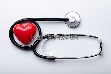 stethoscope with red heart arranged over