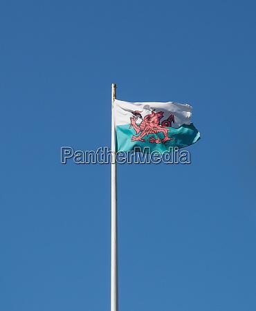 welsh flag of wales over blue