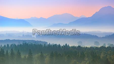 aerial panoramic landscape of alpine foggy