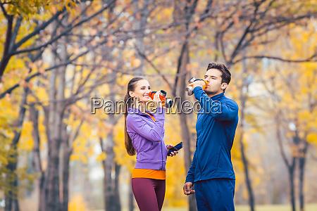 sport couple drinking water having break