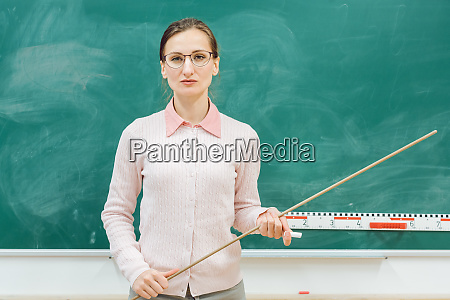 strict teacher standing in front of
