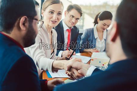 team of business people negotiating an