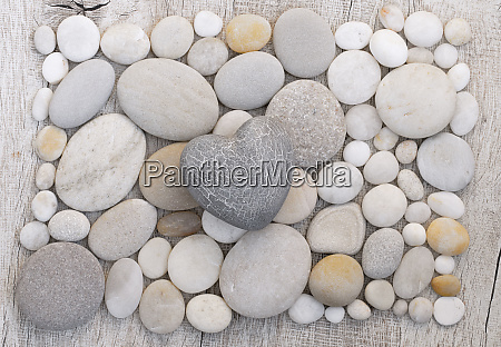 simple grey heart on pebble background
