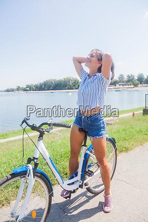 pretty woman having fun riding bicycle