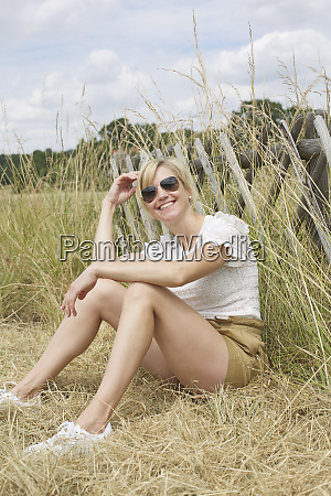 portrait confident carefree woman sitting in