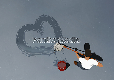man drawing heart shape with mop