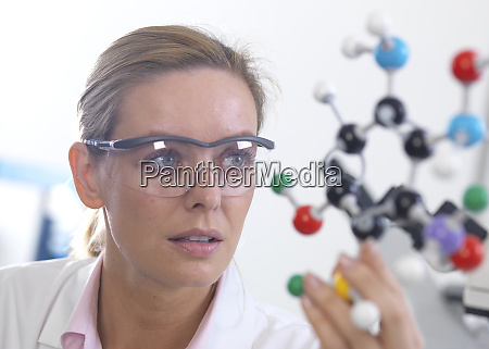 scientist understanding a chemical formula using