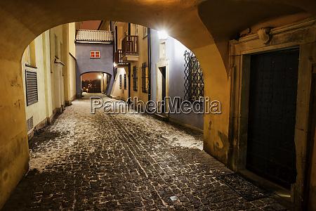 cobbled street on winter night in