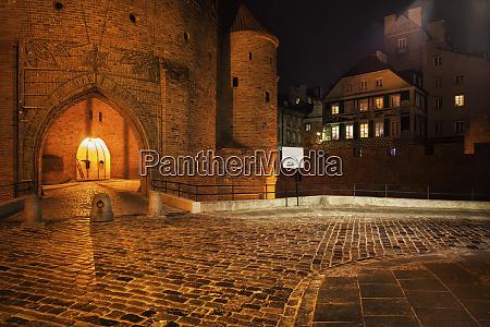 cobblestone street and barbican gate to