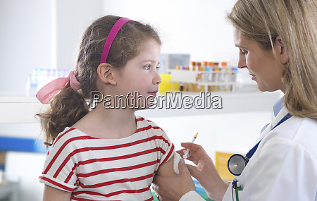 female doctor giving a young girl