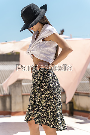 fashionable young woman wearing hat wrap