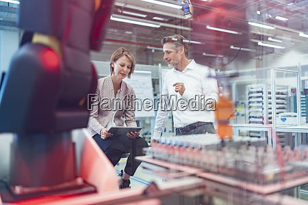 businessman and businesswoman talking in a