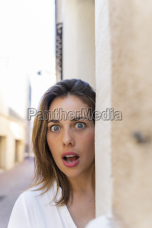 young woman with open mouth in