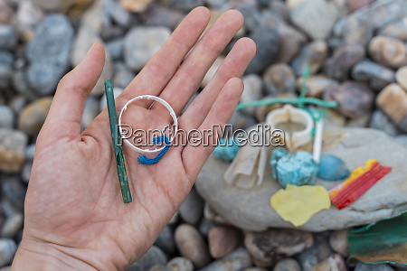 womans hand with plastic waste