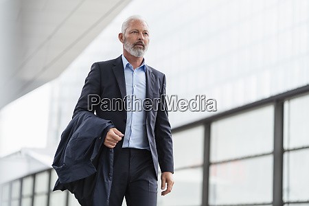 mature businessman on the go