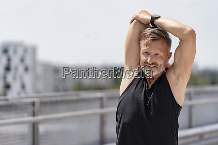 sporty man stretching outside