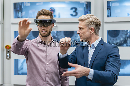two businessmen with ar glasses in