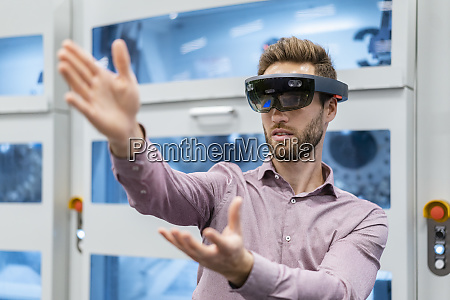 businessman wearing ar glasses in a