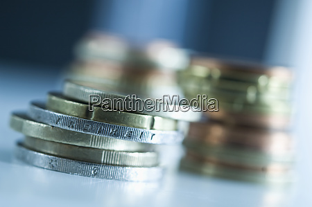 stack of euro coins with inscription