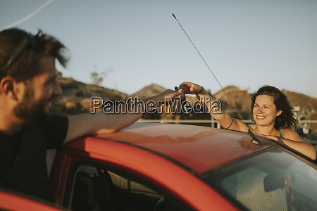 couple exchanging car keys on a