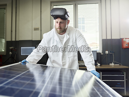 technician with vr glasses controlling solar