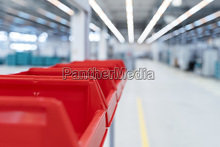 row of red plastic containers in