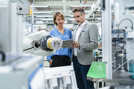 businessman with tablet and woman talking