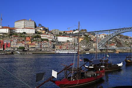 traditional rabelo boats porto city skyline