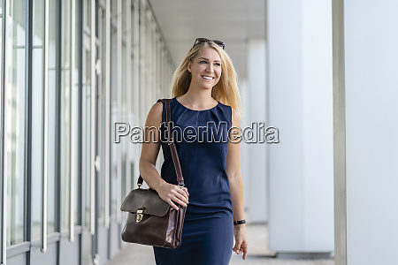 portrait of smiling blond businesswoman with
