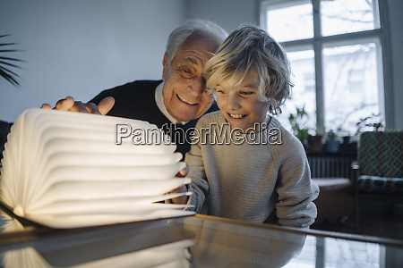 happy grandfather and grandson looking at