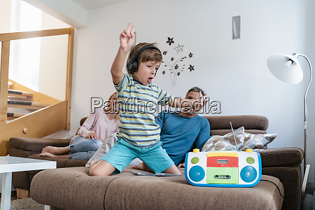 excited boy listening to music with