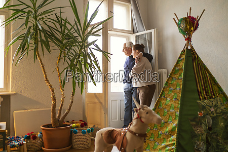 senior couple standing in childrens room