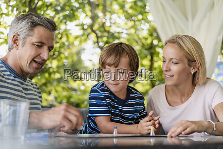 happy parents and son playing a